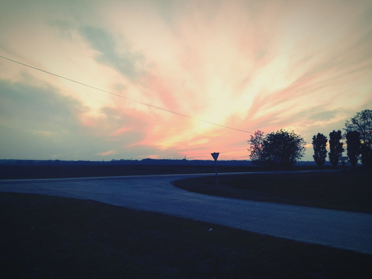 sunset, silhouette, tree, sky, nature, cloud - sky, scenics, outdoors, tranquil scene, beauty in nature, road, tranquility, real people, water, day