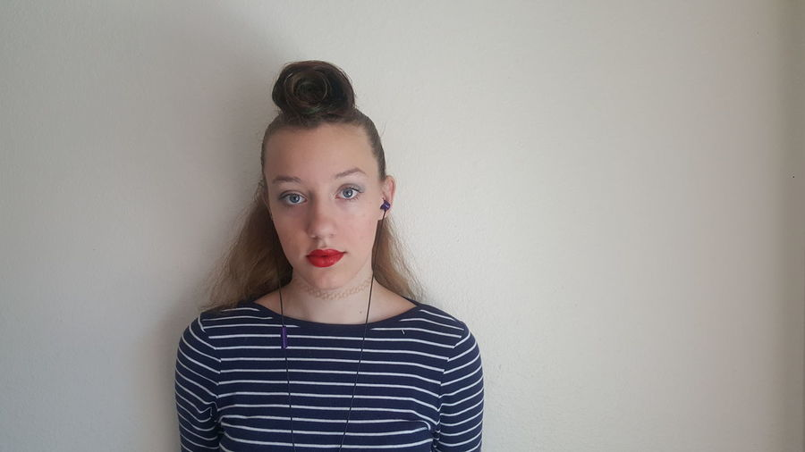Portrait Of Teenage Girl Against Wall