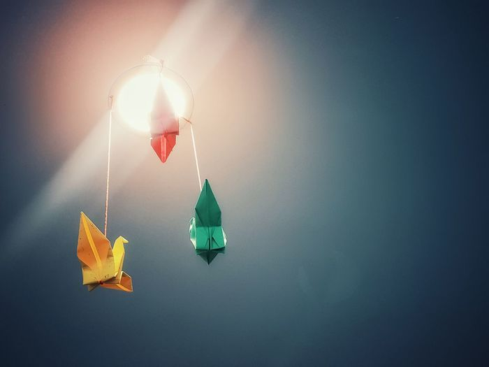 Bird Origami. Paper Birds Origami. Hanging birds mobile. Origami cranes. Hanging origami cranes. Hanging Sky Origami Cranes Origami Art Origamicolors Origami Bird EyeEmNewHere Into The Sky Evening Colors Perspective From Below Sunshine And Shadows Papercraft Paper Cranes Multi Colored Multicolors  Lamp Light Lamp Lights In Decorations Decorationideas