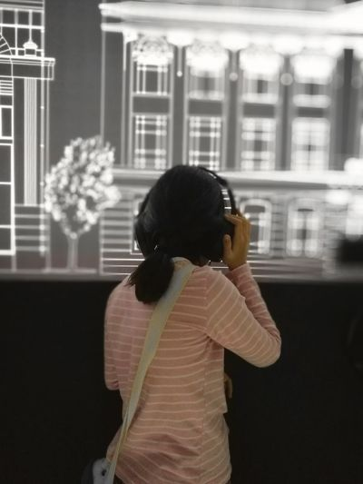 One Person Rear View One Woman Only Architecture Wireless Technology Technology Indoors  Building Exterior Listening Music Exibition Center
