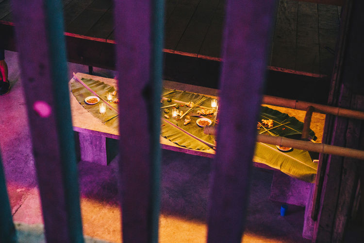 Metal No People Architecture Day Outdoors Illuminated Built Structure Focus On Foreground Boundary Close-up High Angle View Barrier Railing Yellow Purple Fence Nature Wood - Material Hanging