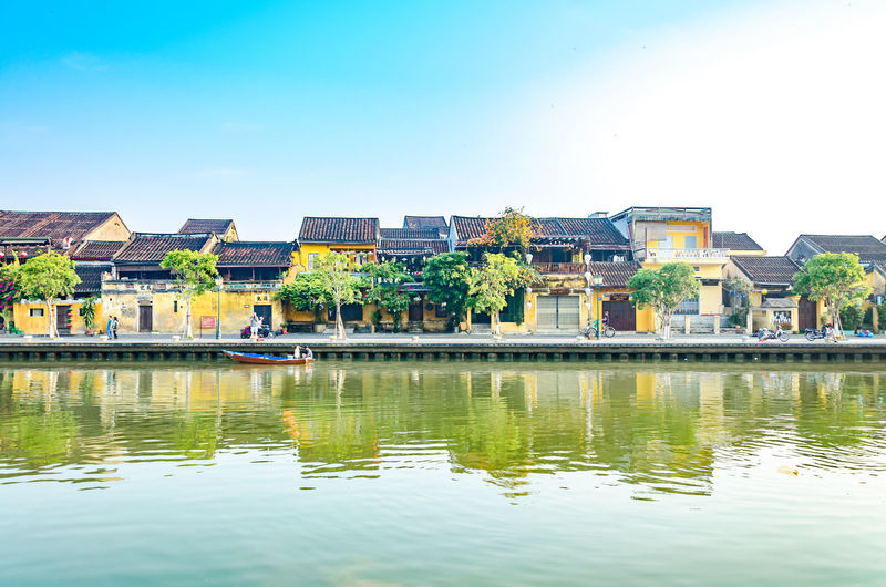Apartment Architecture Blue Building Building Exterior Built Structure City Clear Sky Copy Space Day House Lake Nature No People Outdoors Reflection Residential District Sky Water Waterfront