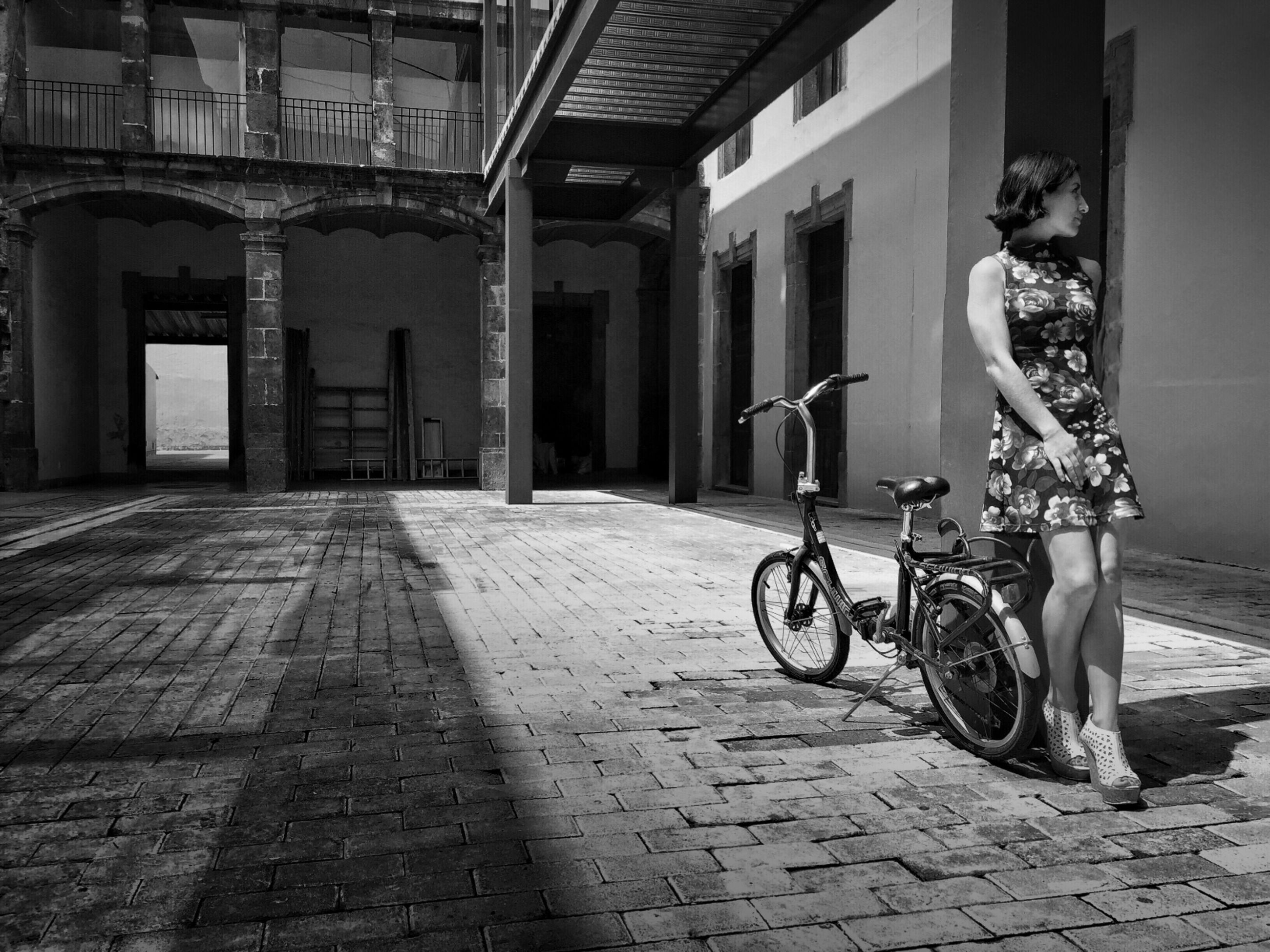 architecture, bicycle, built structure, building exterior, transportation, mode of transport, land vehicle, stationary, parking, parked, street, building, city, cobblestone, window, day, door, travel, sidewalk