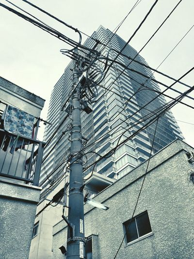 Low Angle View Architecture Building Exterior Built Structure Outdoors No People Day Power Line  Sky Connection Technology EyeEmJapan Japan Photography Architecture Electricity  Electricity Pylon Urban Landscape Urbanphotography Fire Escape Streetphotography Street Photography
