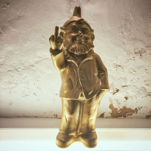 "Amusing garden gnome ""giving the bird"" Angry Art And Craft Creativity Disrespectful  Dwarf Finger Garden Giving The Bird Gnome Gnomes Gold Golden Grumpy In The Air Middle Finger Middle Finger Up Raised Rude Standing Statue Statuette Up Vignette"