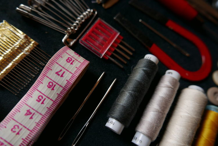 Close-up of sewing kit arranged on table