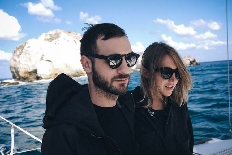 EyeEmNewHere This Is My Skin WeekOnEyeEm Beard Couple - Relationship Fashion Glasses Leisure Activity Lifestyles Men Nautical Vessel Outdoors Portrait Positive Emotion Real People Sea Sky Smiling Sunglasses Togetherness Two People Water Young Adult Young Men
