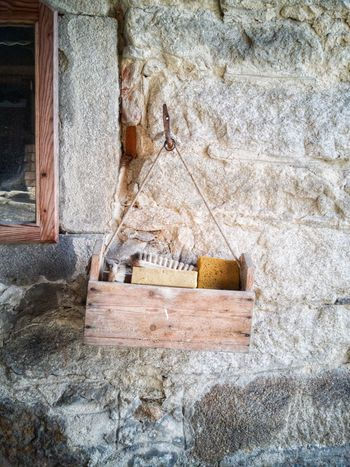 A wooden box on a wall Wooden Wooden Box Box Wall Hanging Wall Of Stone Outdoors Equipment Working House Day Architecture Outdoors Built Structure Building Exterior Close-up