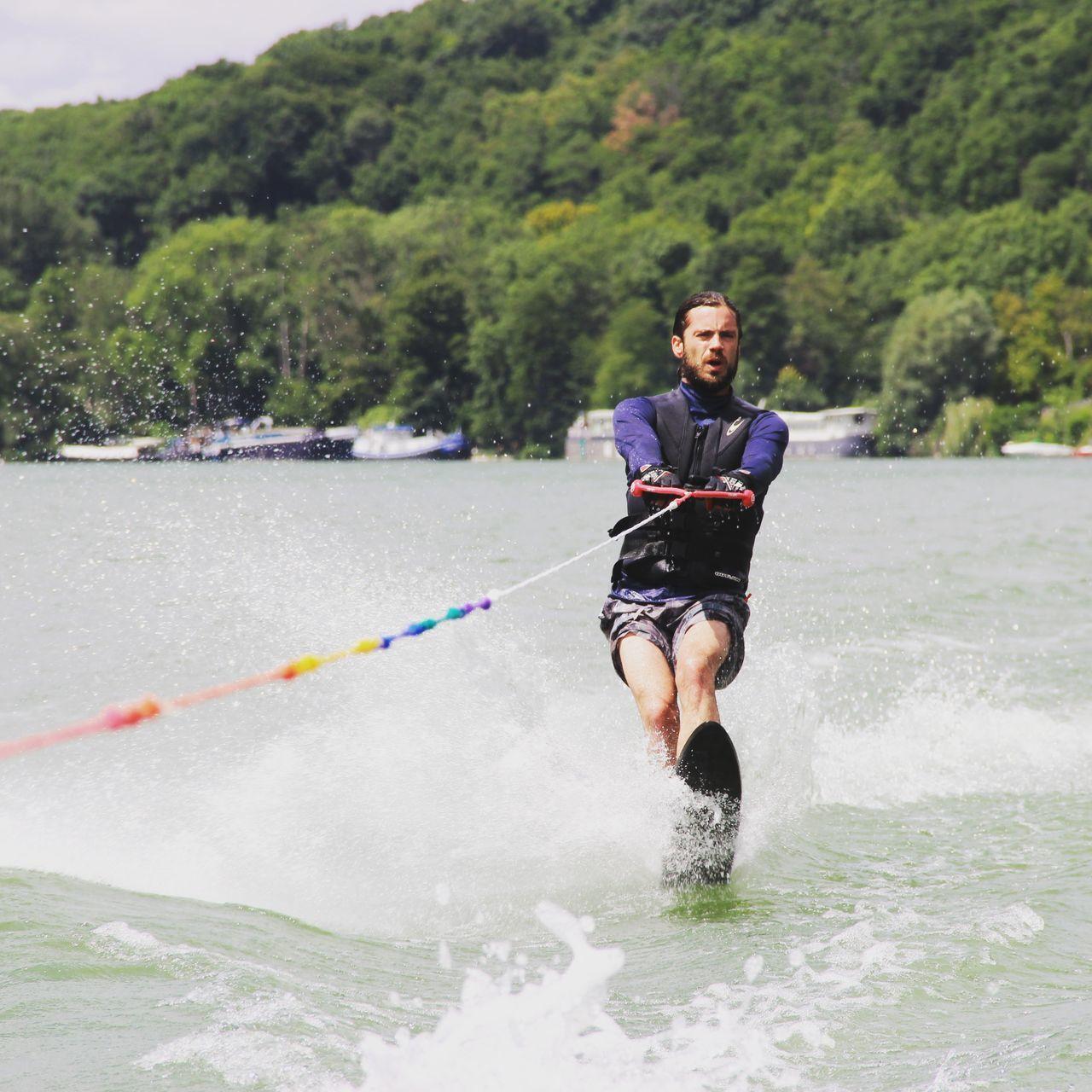 Man Waterskiing In River