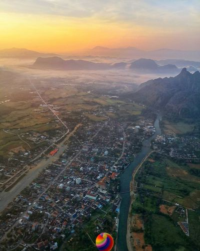 the first light in the morning Morning Hotairballoon Village Vangvieng,Laos Sunrise City Cityscape Sunset Multi Colored Aerial View Business Finance And Industry Road