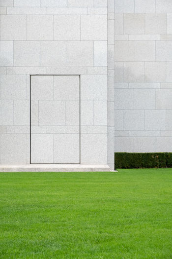 The Week on EyeEm Minimal Minimalism Minimalobsession Minimalist Architecture Minimalist Abstract Door Doorway Grass Plant Green Color Architecture Lawn No People Day Built Structure Sport Nature Absence Copy Space Wall - Building Feature Outdoors Building Exterior Land Backgrounds