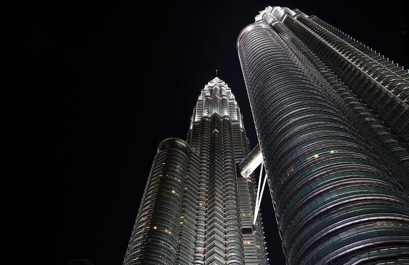 Low angle view of skyscraper at night