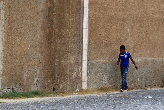 Blue T-shirt Brown Wall Capo Verde Childhood Day Full Length One Boy Only One Person Outdoors Sal Island Santa Maria Street Photography Summer 2015