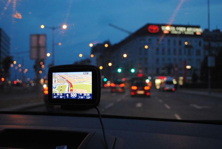 Automotive navigation system on dashboard in car
