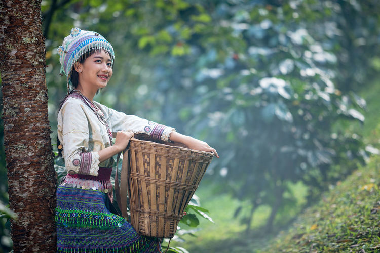 Young woman Hmong traditional dress and enjoying in coffee garden at Doi Pui Chiang Mai Thailand. Basket One Person Women Container Smiling Happiness Nature Adult Standing Day Three Quarter Length Emotion Clothing Plant Females Front View Focus On Foreground Leisure Activity Outdoors Hmong ASIA Chiang Mai | Thailand Coffee Argiculture Harvet International Women's Day 2019