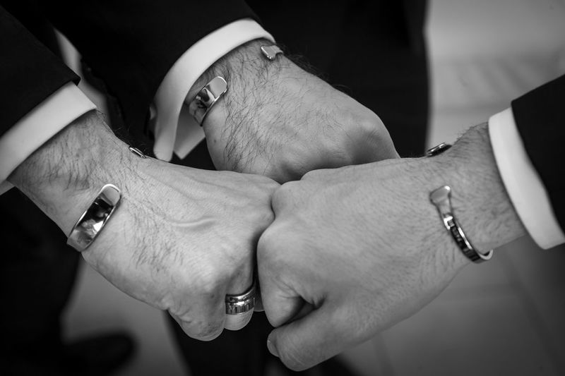 Human Hand Hand Jewelry Human Body Part Ring Real People Love Togetherness Adult Men Women People Two People Holding Positive Emotion Focus On Foreground Indoors  Couple - Relationship Bonding Wristwatch Body Part Finger Care