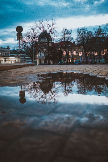 Reflection #2 in Sofia #Bulgaria #City #Sofía #cityscapes #europe #travel #travelling #travelphotography #urban #urban Scene #urbanexploration  #urbanphotography Building Exterior Built Structure City Cold Temperature Day Nature No People Outdoors Puddle Reflection Tree Water Winter