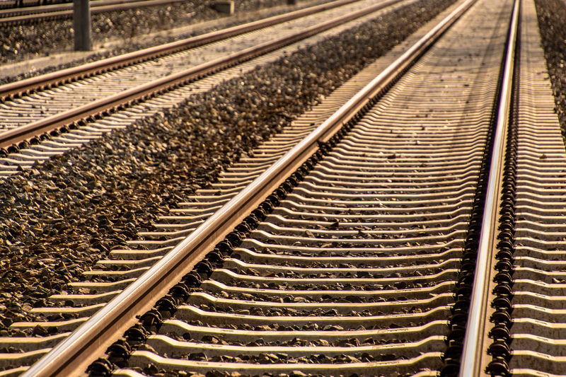 Alloy Backgrounds Day Diminishing Perspective Direction Gravel High Angle View In A Row Intertwined Large Group Of Objects Metal Mode Of Transportation No People Parallel Pattern Public Transportation Rail Transportation Railroad Tie Railroad Track Steel The Way Forward Track Transportation Travel vanishing point