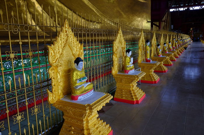 Row of Gold Buddha Shrines at Kyauk Htat Gyi Pagoda Buddha Statues Buddhism Buddhist Culture Buddhist Pagoda Buddhist Temple Composition Distant Perspective Full Frame Full Length Gold Coloured In A Row Indoor Photography Kyauk That Gyi Pagoda Myanmar No People Place Of Pilgrimage Place Of Prayer Place Of Worship Religion Side By Side Spirituality Tourist Attraction  Tourist Destination Travel Destination Yangon