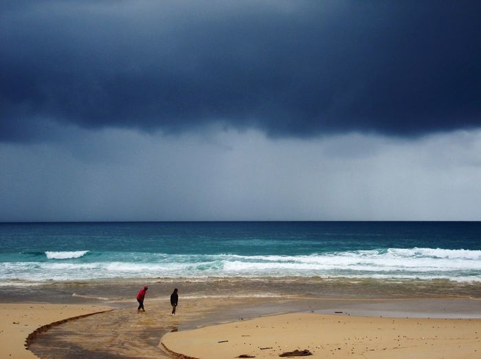 Stormy Weather Storm Clouds Couple Bathing Beachlovers Breakin' Waves Sea, Sand, Sky Beach Life Colour Stripes Dark Clouds Landscape