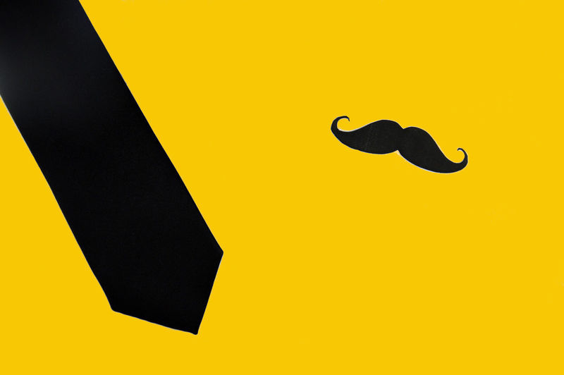 movember, necktie and mustache on yellow background Cancer Man Movember November Art And Craft Black Color Healthcare And Medicine Healthy Eating Let It Grow Mustache Prevention Silhouette Yellow Yellow Background