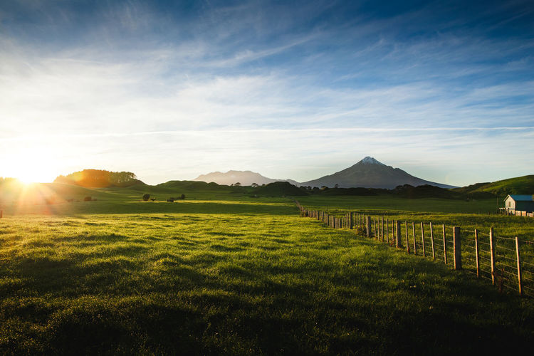 Beauty In Nature Bright Cloud - Sky Environment Field Grass Green Color Idyllic Land Landscape Lens Flare Mountain Nature No People Non-urban Scene Outdoors Plant Scenics - Nature Sky Sun Sunlight Tranquil Scene Tranquility