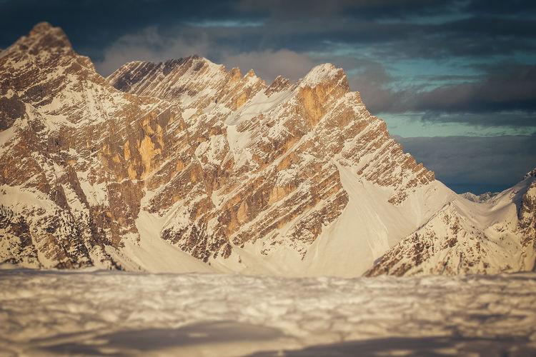 Tilt shift effect of snowy slopes of torre sabbioni peaks at sunset