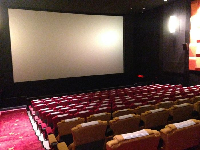 Arts Culture And Entertainment Auditorium Chair Cinema Film Industry Illuminated In A Row Indoors  Lighting Equipment MOVIE Movie Theater Nightlife No People Projection Screen Red Seat Theater