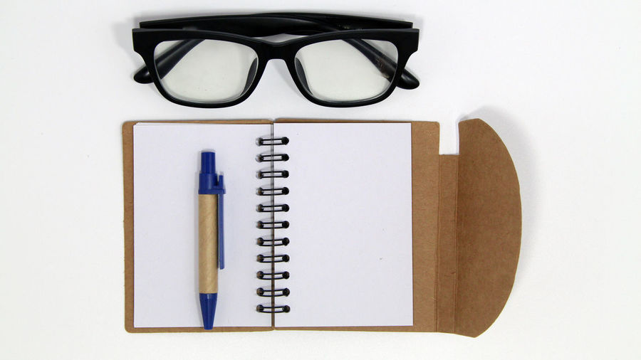 Blank Book Close-up Copy Space Creativity Directly Above Education Eyeglasses  Glasses Indoors  Learning No People Note Pad Pen Pencil Publication Reading Glasses School Supplies Still Life Studio Shot Studying White Background Writing Instrument