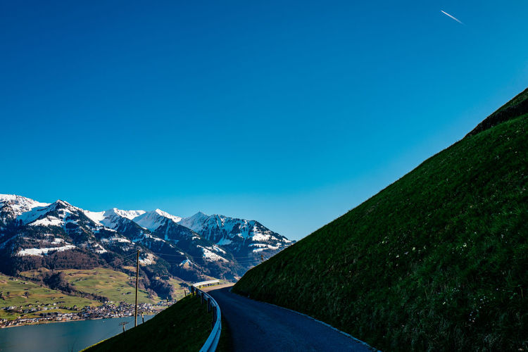 Beauty In Nature Blue Clear Sky Copy Space Country Road Diminishing Perspective Landscape Mountain Mountain Range Nature Non-urban Scene Obwalden Road Sarnen Scenics Snow Switzerland The Way Forward Tranquil Scene Tranquility Transportation Vanishing Point Winter