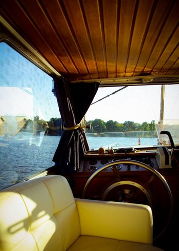 My Eyes My Berlin On A Boat Old Boat River View Summer Views Is This Seat Taken? Starting A Trip Creative Light And Shadow Stillness In Time Steering Wheel Travel Color Design Space Design Photographic Memory Transportation