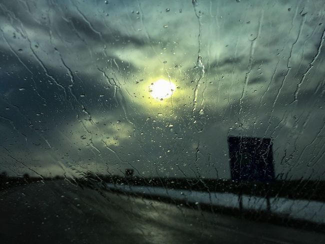 Water against the windshield looks so cool Highways And Byways Driving Sun Sky And Clouds Dark Clouds Daylight Water Droplets Windshield Nature