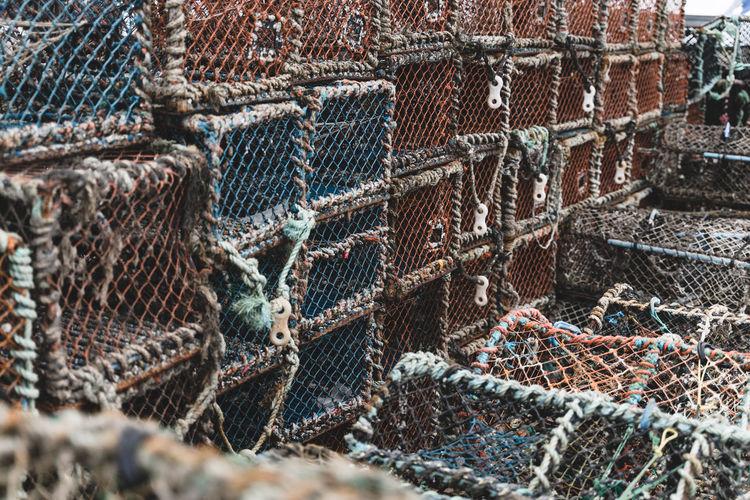 Close-up of crab pot at harbor