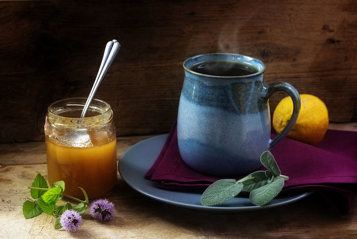 Herbal tea against cold with fresh sage, mint, honey and lemon in a blue mug on a rustic wooden board, health concept, home remedies to strengthen the immune system and flu prevention Hot Rustic Sage Tea Wood Alternative Medicine Blue Cold Cup Drink Flu Food And Drink Healing Herbs Health Herbal Home Remedies Honey Illness Immune System Leaf Lemon Mint Mug Prevention Wood - Material