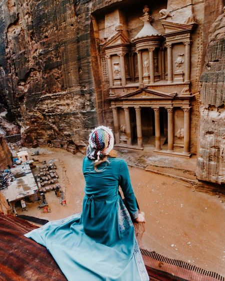 Rear view of woman looking at historic building