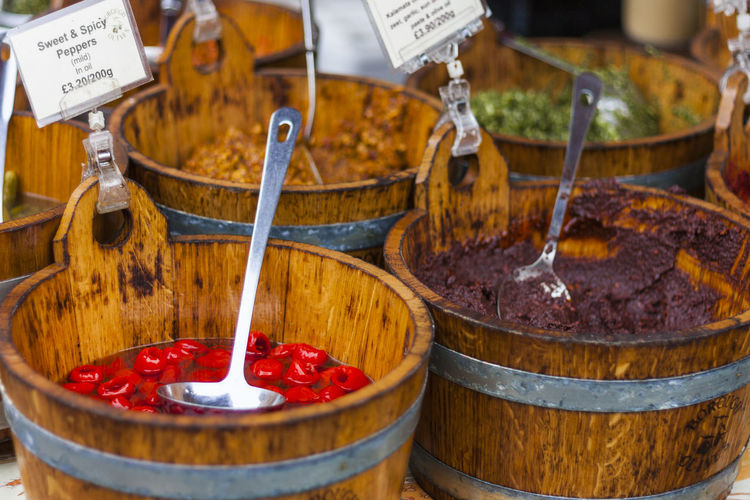 Close-up of preserves in wooden buckets for sale
