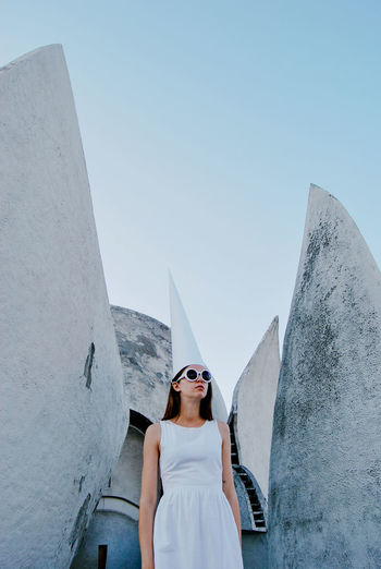 Leisure Activity Architecture Built Structure Women Sky Wall - Building Feature Lifestyles Real People Girl Wizard Weird Strange Surreal Fantasy Architecture Surrealism Sunglasses Young Adult Young Women Building Exterior Fashion Front View Beautiful Woman Standing Space