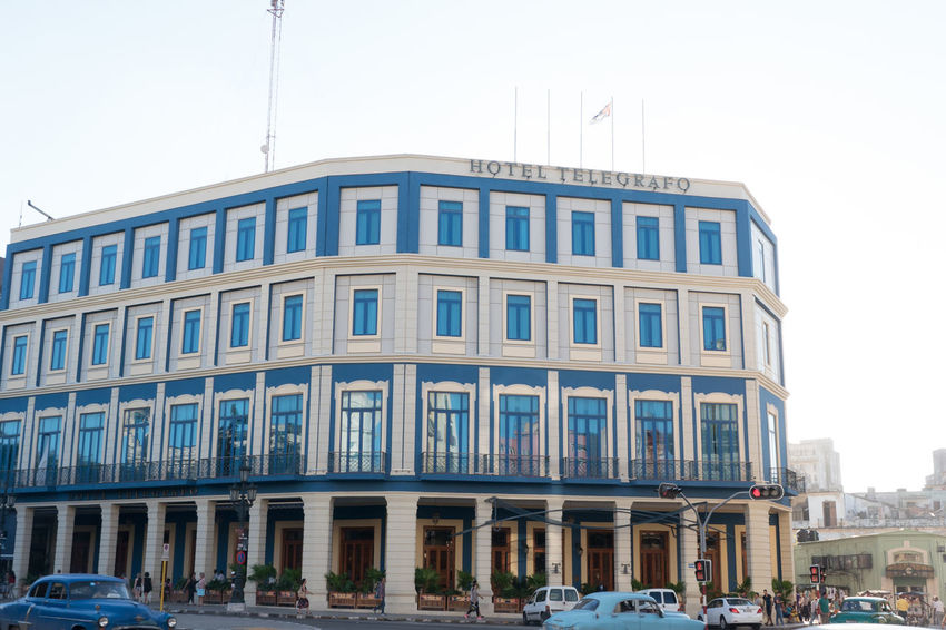 Hotel Telégrafo Architecture Building Exterior Built Structure Car Centro Habana City Cityscape Clear Sky Cuba Cuba Collection Day Façade Outdoors Street Photography Tourism Traffic Lights Travel Destinations Travelling Photography Unrecognizable People Urban Road