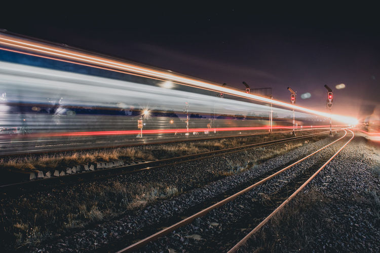 Light trails on railroad track at night