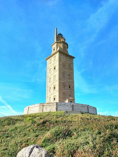 Torre De Hércules La Coruña Sky Lighthouse Cloud - Sky History Outdoors Architecture Day No People Blue Building Exterior Grass Clock Face