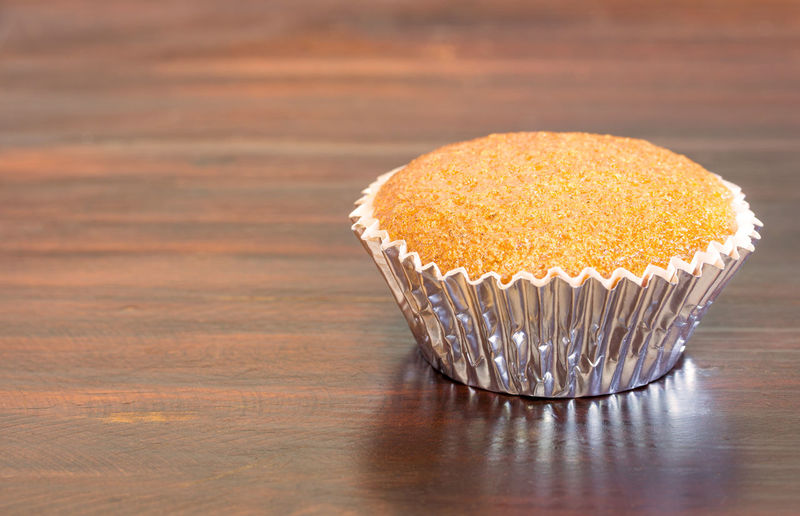 Banana cupcake on wooden table Cake Banana Cupcakes Dessert Snack Sugar Baked Bakery Bread Close-up Cupcake Delicious Dessert Food Food And Drink Freshness Homemade Cake Indoors  Muffin No People Ready-to-eat Sweet Food Table Yummy First Eyeem Photo