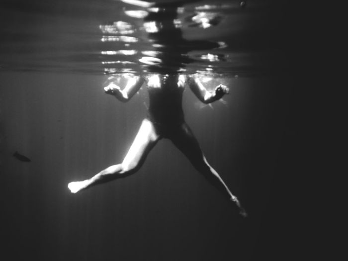 Water Underwater Sea Swimming One Person UnderSea Full Length Nature Leisure Activity Real People Lifestyles Swimwear Clothing Motion Women Rear View Sunlight Trip Human Arm Swimming Pool Human Body Underwater Diving Light And Shadow Black And White Floating On Water