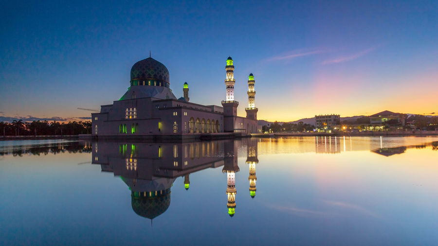 reflection of Likas Mosque Reflection Building Exterior Water Architecture Built Structure Sky Waterfront Travel Destinations Religion Spirituality Nature Building Belief Dome No People Lake Place Of Worship Travel Government