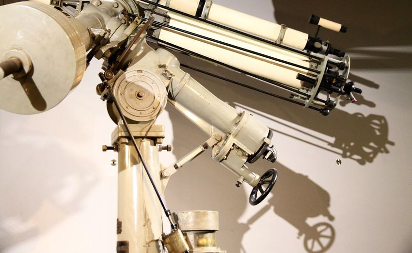 Astronomical telescope against wall