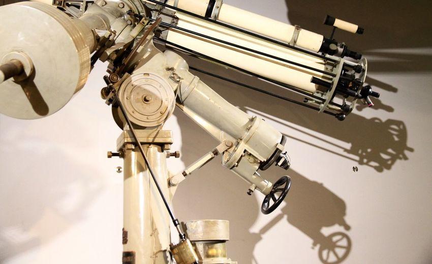 Astronomical telescope. Taking Photos Light And Shadow Retro Telescope