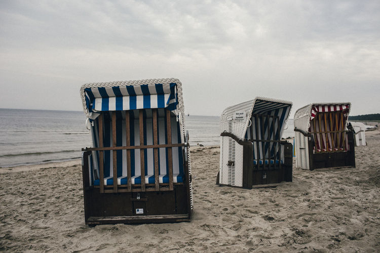Seats on shore against the sea