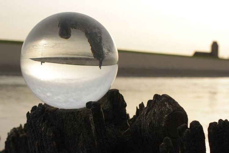 Waddenzee bij Wierum Water Sunlight Beauty In Nature Glass Ball Taking Photos No People Friesland Fryslan Waddenzee Wadden Sea Hello World
