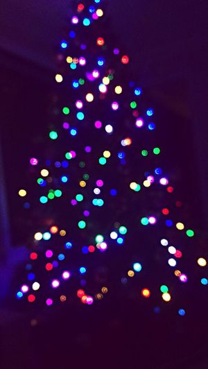 """Hope is being able to see that there is light despite all of the darkness""-Desmond Tutu Blurred Lights Christmas Lights Illuminated Multi Colored Christmas Tree"