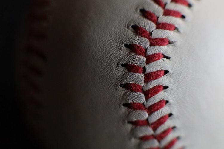 Red saw in baseball ball