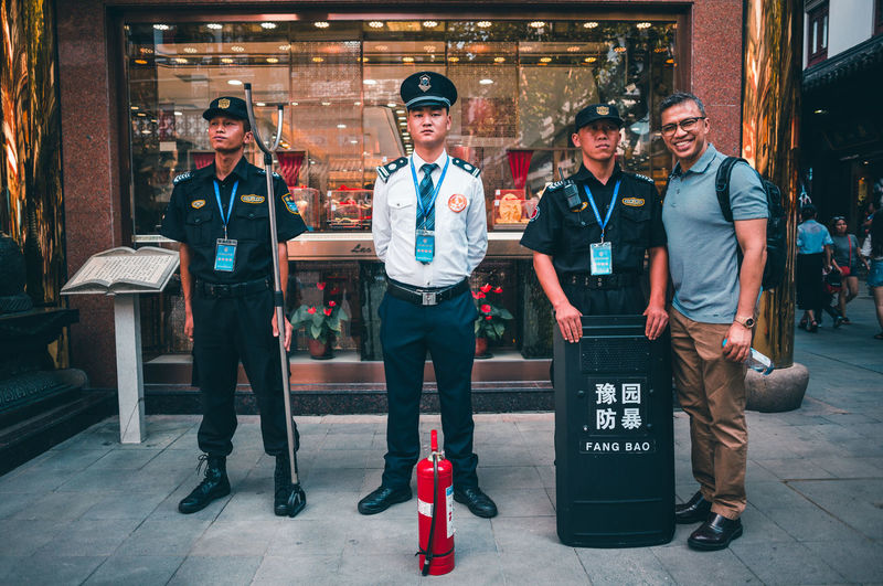 The art of observing without moving. Real People Looking At Camera Young Men Young Adult Portrait Group Of People Men Lifestyles Full Length Smiling Adult Uniform Front View Standing People Males  Police